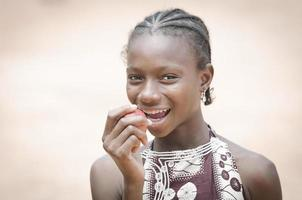 Gorgeous Young African Girl Biting A Red Apple: Healthy Lifestyle