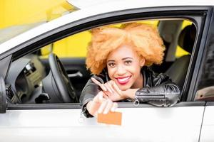 Portrait of a beautiful african woman in the car