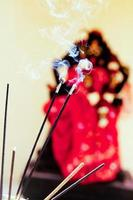 burning incense in temple photo