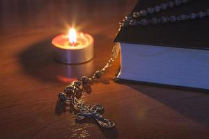 Rosary beads and a holy bible photo