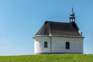Rural baroque chapel on the horizon