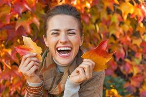 Portrait of happy young woman with leafs