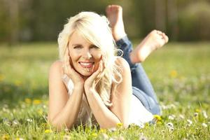 Happy woman lying on a meadow