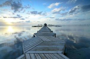 Cloudscape with reflections in a zigzag dock