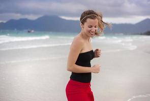 Woman jumping at the beach.
