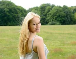 Blond young woman in park photo