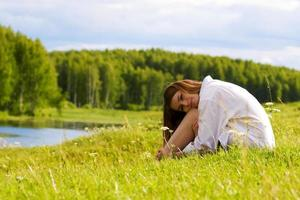 Young woman relaxing on nature