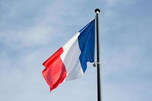 French flag under blue sky photo