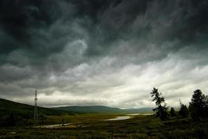 Black stormy sky in the rain mountains. Altai.