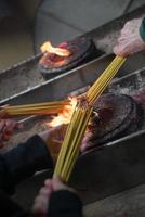 Incense sticks lighting photo