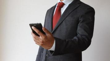 Businessman using mobile phone video
