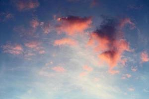 red clouds on blue sky photo