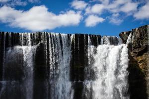 Waterfall with sky backdrop looks surreal
