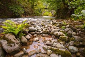 mountain river with stones and sky