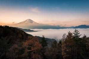 Mount Fuji enshrouded in clouds with clear sky