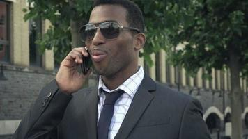 young African American Businessman Using Mobile Phone video