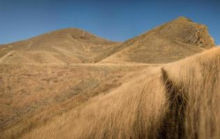 Dry hills and blue sky photo