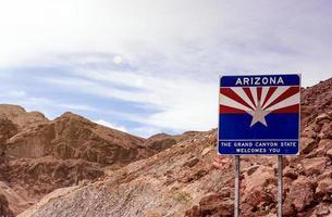 Arizona State Border Highway Sign Against Sky Blue Background photo
