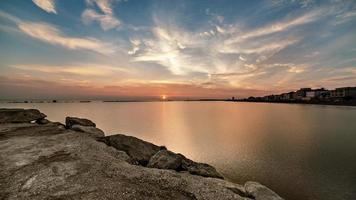 sunrise from sea with dramatic intense sky. Amazing landscape photo