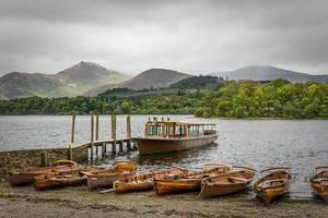 Keswick Boat Landing With Moody Cloudy Sky And Mountains. photo