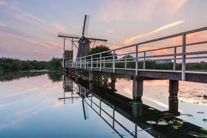 kinderdijk windmill with bridge photo