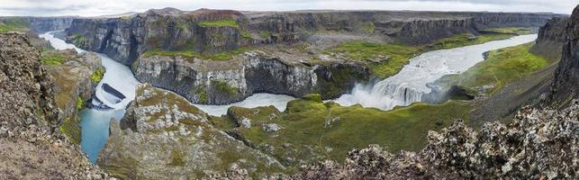 Watwerfall Hafragilsfoss in the rain and cloudy sky, Iceland