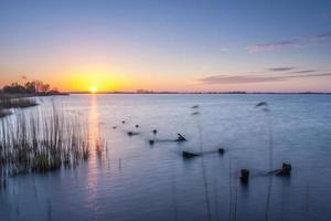 puesta de sol sobre el lago, schildmeer