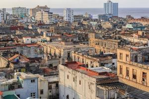 old antique Cuban Havana city against ocean and sky background