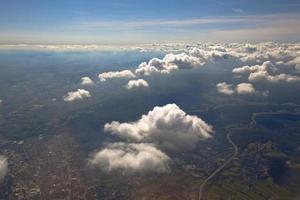 White clouds in a blue sky. Aerial view from airplane. photo