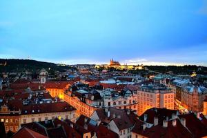 Cityscape of Old Town of Prague in dark night sky