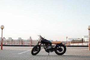 Motorbike on parking in city  with open sky on background