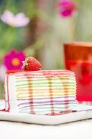 Rainbow cheesecake with fresh strawberries