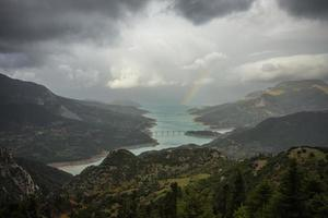 Scenic view from the mountain to the lake and rainbow