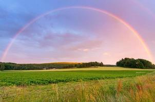 Rainbow over Swedish field photo