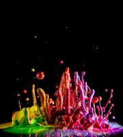 Colorful paint splashing photo