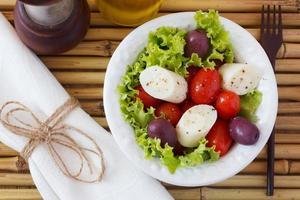 Salad of heart of palm (palmito), cherry tomatos, olives, black