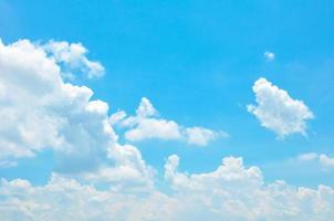 Beautiful bright summer blue sky and clouds as background photo