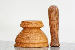 Pestle and mortar made of coconut tree photo