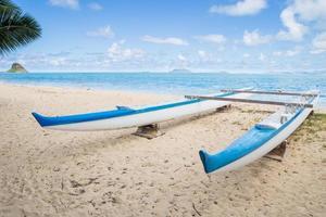 Boat on Hawaiian beach photo