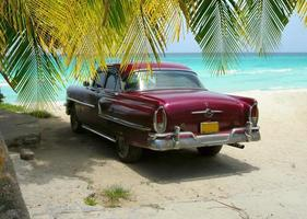Cuba Beach classic car and palms