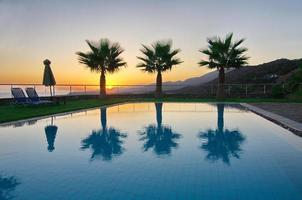 Palm Trees and Pool in an Aegean sunrise photo