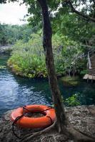 Life buoy on lake background photo