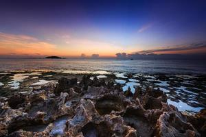 Volcanic rocks on the coast at dawn