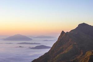 Sea of mist at Doi Pha Tang, Chiangrai , Thailand photo