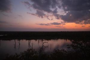 Sunset over a lake in Kruger