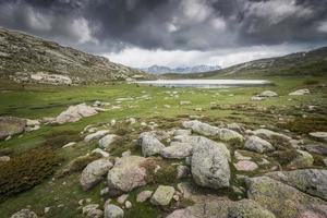 View across Lac De Nino in Corsica and mountains photo