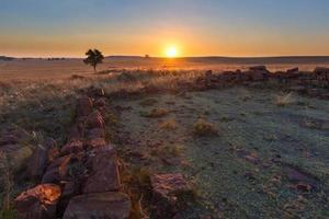 puesta de sol en un klipkraal foto