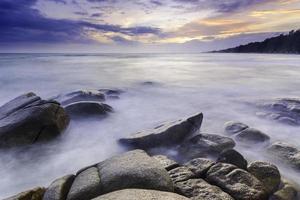 Sea stones at sunset photo