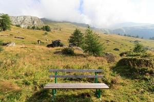Bench and mountain in the Alps, Austria