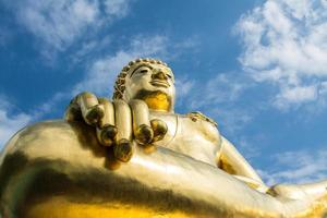 Big golden buddha statue with blue sky at Chiangrai, Thailand